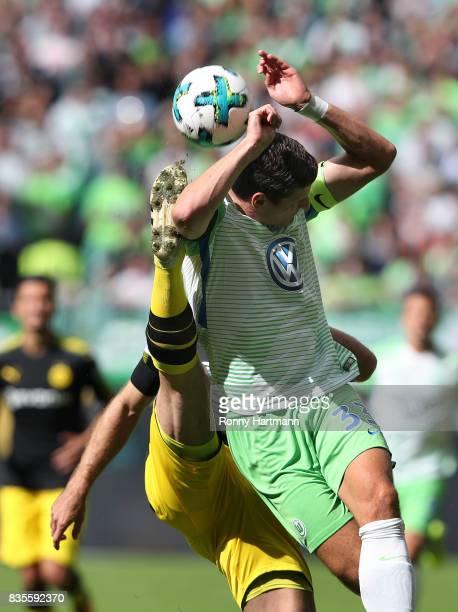 Mario Gomez of Wolfsburg is attacked by Sokratis of Dortmund during the Bundesliga match between VfL Wolfsburg and Borussia Dortmund at Volkswagen...