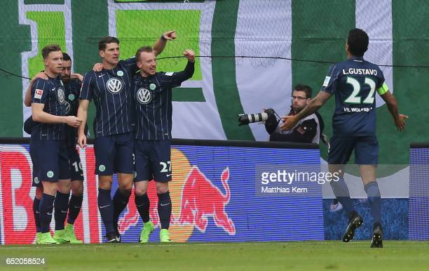 Mario Gomez of Wolfsburg jubilates with team mates after scoring the first goal during the Bundesliga match between RB Leipzig and VfL Wolfsburg at...