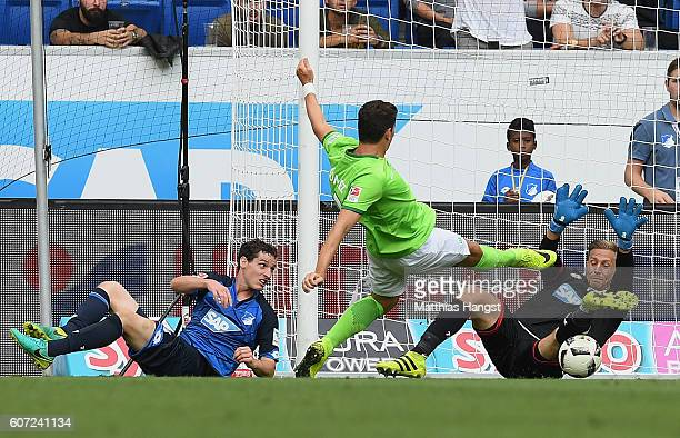 Mario Gomez of Wolfsburg misses to score against goalkeeper Oliver Baumann of Hoffenheim during the Bundesliga match between TSG 1899 Hoffenheim and...