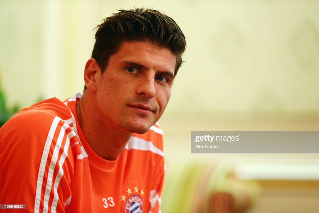 Mario Gomez talks to the media during a Bayern Muenchen press conference at the Grand Heritage Hotel on January 4, 2013 in Doha, Qatar.