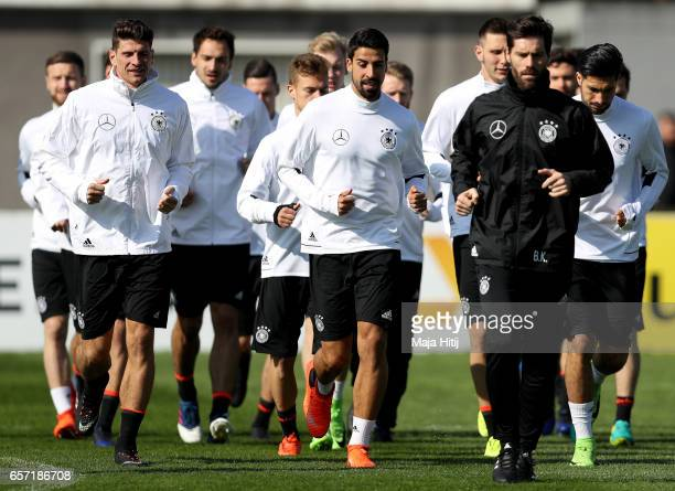 Mario Gomez warms up next to Sami Khedira during a Germany training session on March 24 2017 in Kamen Germany