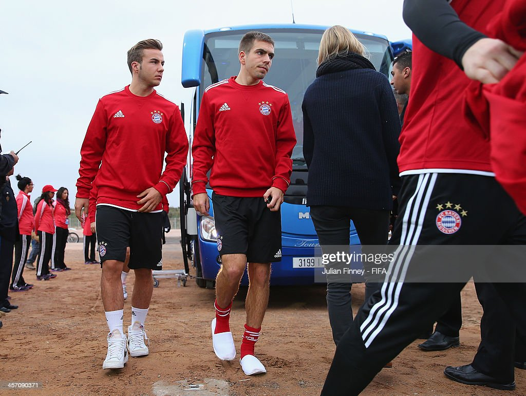 Mario Gotze and <a gi-track='captionPersonalityLinkClicked' href=/galleries/search?phrase=Philipp+Lahm&family=editorial&specificpeople=483746 ng-click='$event.stopPropagation()'>Philipp Lahm</a> of Bayern Muenchen arrive during a training session outside the Agadir Stadium on December 16, 2013 in Agadir, Morocco.