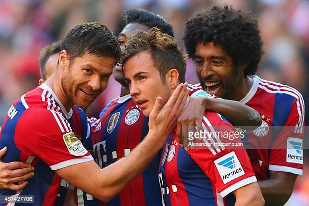 Mario Gotze of Bayern Muenchen celebrates scoring their fourth goal with team mates during the Bundesliga match between FC Bayern Muenchen and SV...