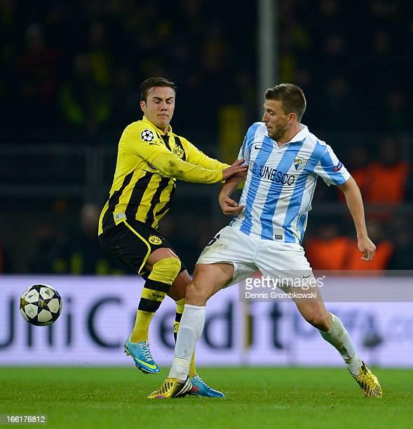 Mario Gotze of Borussia Dortmund and Ignacio Camacho of Malaga compete for the ball during the UEFA Champions League quarterfinal second leg match...