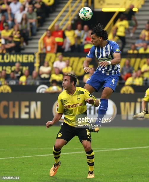 Mario Gotze of Borussia Dortmund challenges with Karim Rekik of Hertha BSC Berlin during the Bundesliga soccer match between Borussia Dortmund and...