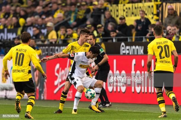 Mario Gotze of Borussia Dortmund Julian Weigl of Borussia Dortmund Lars Stindl of Borussia Monchengladbach Maximilian Philipp of Borussia Dortmund...