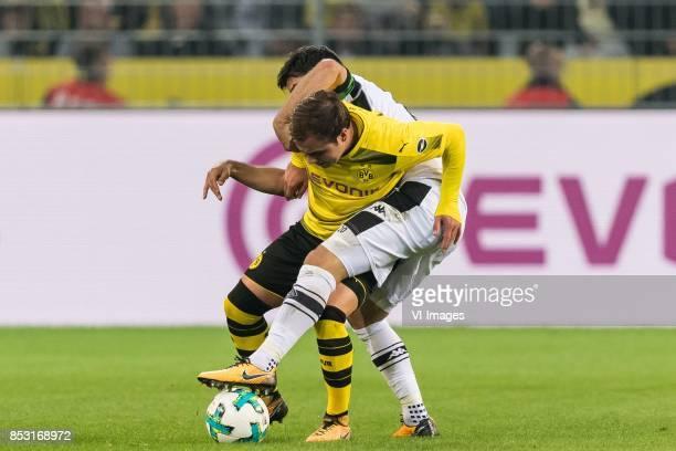 Mario Gotze of Borussia Dortmund Lars Stindl of Borussia Monchengladbach during the Bundesliga match between Borussia Dortmund and Borussia...