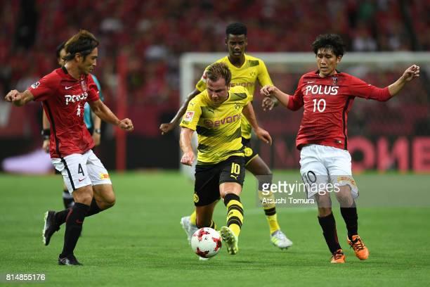 Mario Gotze of Borussia Dortmund runs with the ball during the preseason friendly match between Urawa Red Diamonds and Borussia Dortmund at Saitama...