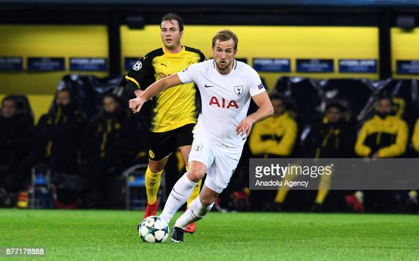 Mario Gotze of Dortmund in action against Harry Kane of Tottenham Hotspur FC during the UEFA Champions League Group H soccer match between Borussia...