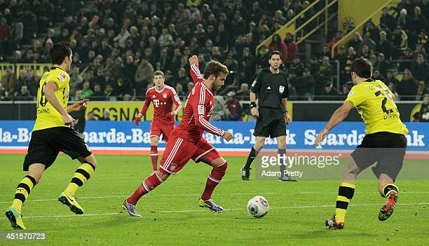 Mario Gotze of FCBayern scores a goal during the Bundesliga match between FC Bayern and Bor Dortmund Signal Iduna Park on November 23 2013 in...