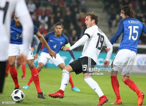 Mario Gotze of Germany Adrien Rabiot of France during the international friendly match between Germany and France at RheinEnergieStadion on November...