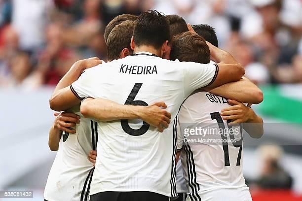 Mario Gotze of Germany celebrates scoring his teams first goal of the game with team mates Benedikt Howedes Toni Kroos Julian Draxler Sami Khedira...