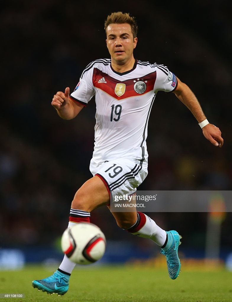 Mario Gotze of Germany runs with the ball during the UEFA Euro