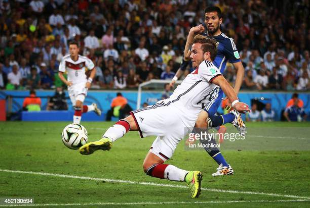 Mario Gotze of Germany scores during the 2014 World Cup final match between Germany and Argentina at The Maracana Stadium on July 13 2014 in Rio de...