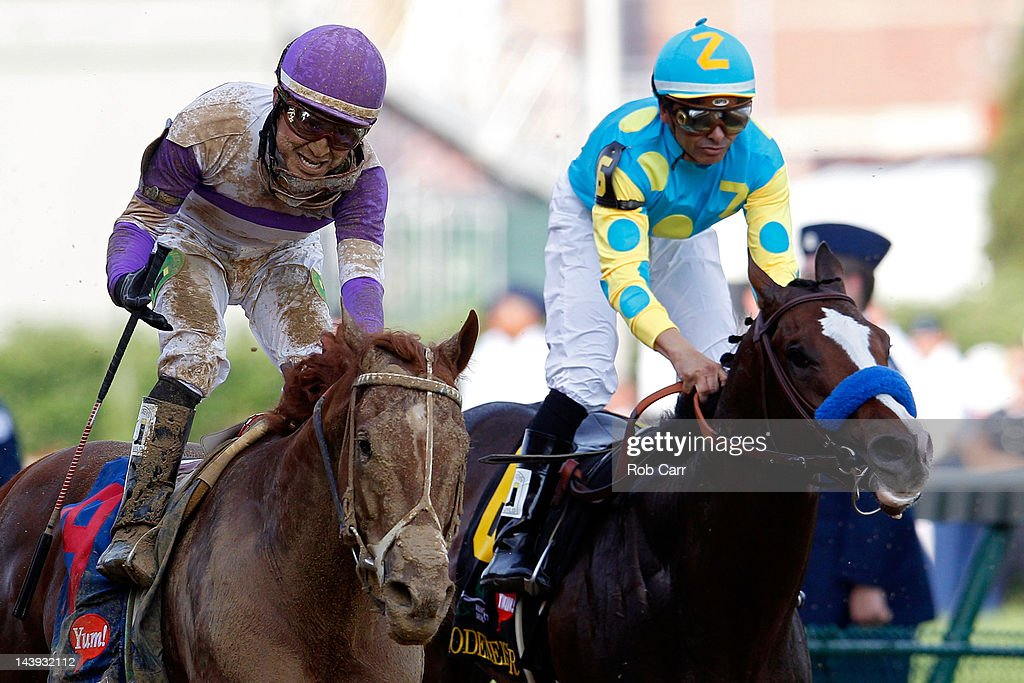 Mario Gutierrez celebrates atop I'll Have Another after winning the 138th running of the Kentucky Derby ahead of Bodemeister ridden by Mike Smith at Churchill Downs on May 5, 2012 in Louisville, Kentucky.