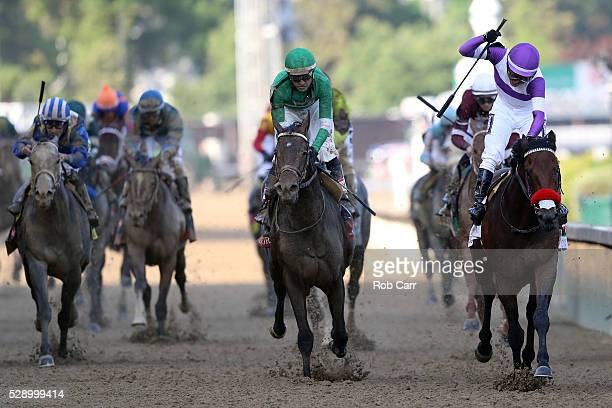 Mario Gutierrez celebrates atop Nyquist after crossing the finish line to win the 142nd running of the Kentucky Derby at Churchill Downs on May 07...