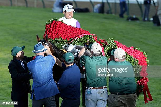 Mario Gutierrez celebrates atop Nyquist after winning the 142nd running of the Kentucky Derby at Churchill Downs on May 07 2016 in Louisville Kentucky