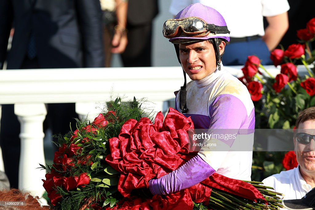 Mario Gutierrez celebrates with the roses atop I'll Have Another after winning the 138th running of the Kentucky Derby at Churchill Downs on May 5, 2012 in Louisville, Kentucky.