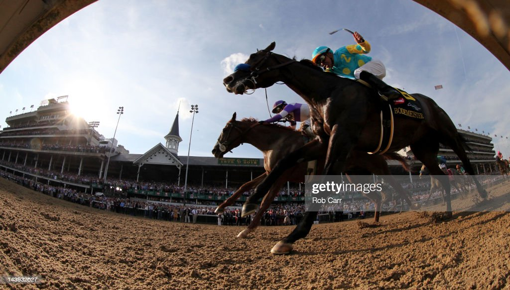 Mario Gutierrez (L) comes down the final stretch atop I'll Have Another ahead of Bodemeister ridden by Mike Smith during the 138th running of the Kentucky Derby ahead of at Churchill Downs on May 5, 2012 in Louisville, Kentucky.