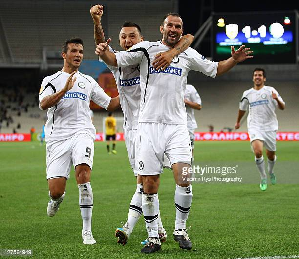 Mario Haas of Sturm celebrates with his team mates after scoring this team's winning goal during the UEFA Europa League Group L match between AEK...