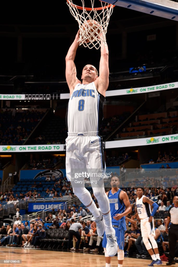 Mario Hezonja #8 of the Orlando Magic dunks against the Dallas Mavericks during a preseason game on October 5, 2017 at Amway Center in Orlando, Florida.