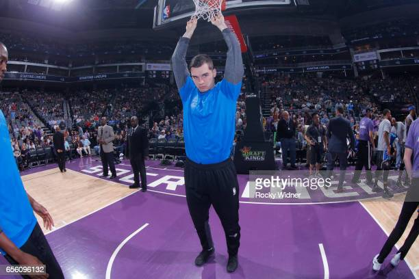 Mario Hezonja of the Orlando Magic holds onto the net prior to the game against the Sacramento Kings on March 13 2017 at Golden 1 Center in...