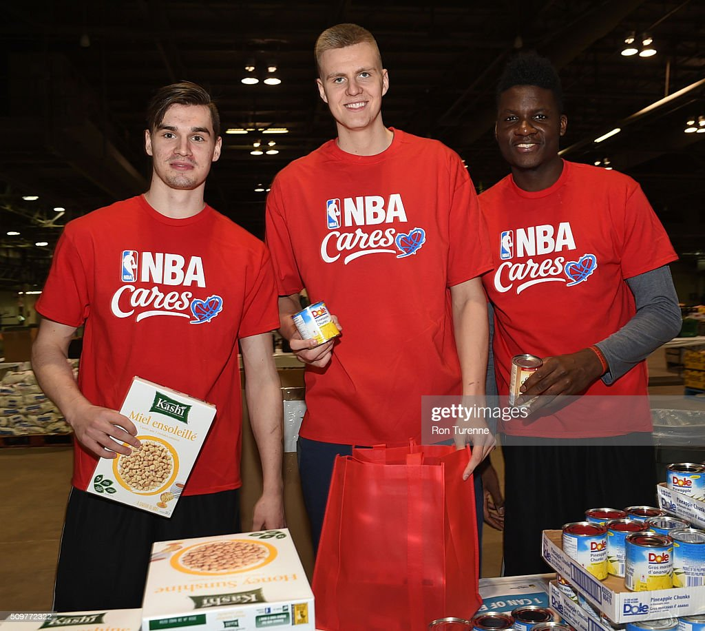 Mario Hezonja of the Orlando Magic, Kristaps Porzingis and Clint Cappela of the Houston Rockets pose for a photo during the NBA Cares All-Star Day of Service as part of 2016 All-Star Weekend at NBA Centre Court of the Enercare Centre on February 12, 2016 in Toronto, Ontario, Canada.