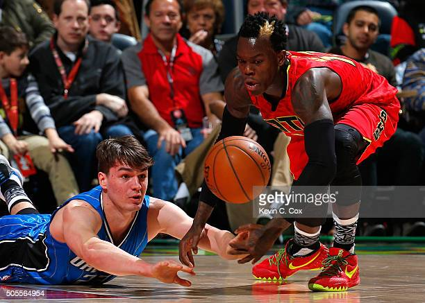 Mario Hezonja of the Orlando Magic saves a loose ball against Dennis Schroder of the Atlanta Hawks at Philips Arena on January 18 2016 in Atlanta...