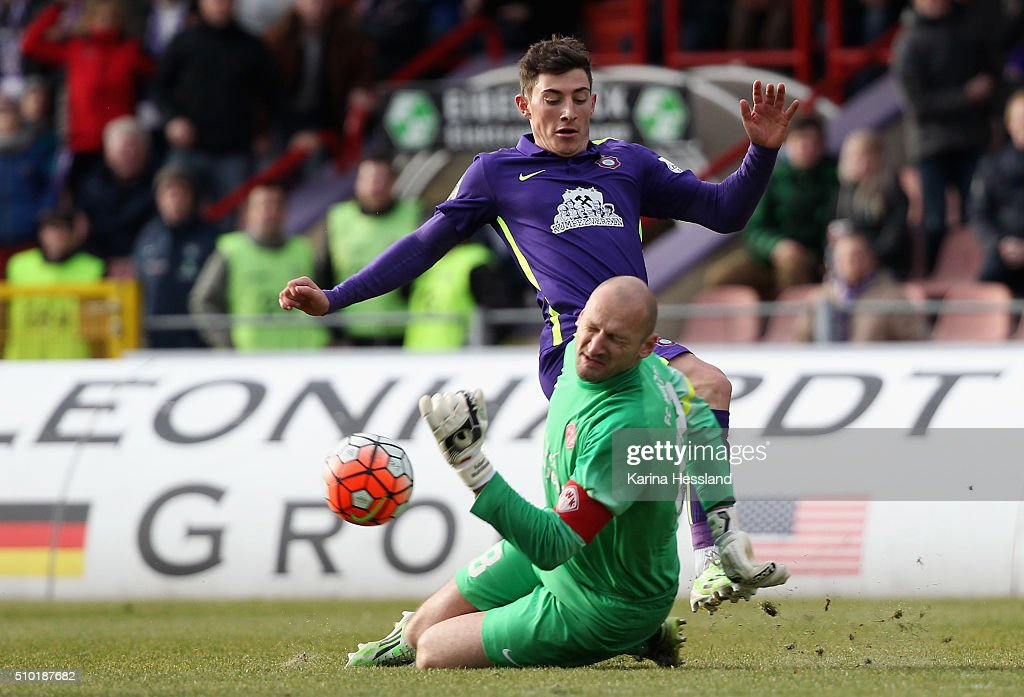 Mario Kvesic of Aue challenges Goalkeeper Robert Wulnikowski of Wuerzburg during the Third League match between FC Erzgebirge Aue and Wuerzburger Kickers at Erzgebirgsstadion on February 14, 2016 in Aue, Germany.