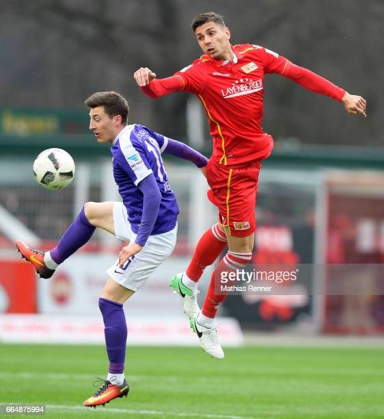 Mario Kvesic of Erzgebirge Aue and Damir Kreilach of 1 FC Union Berlin compete during the game between Union Berlin and Erzgebirge Aue on april 5...