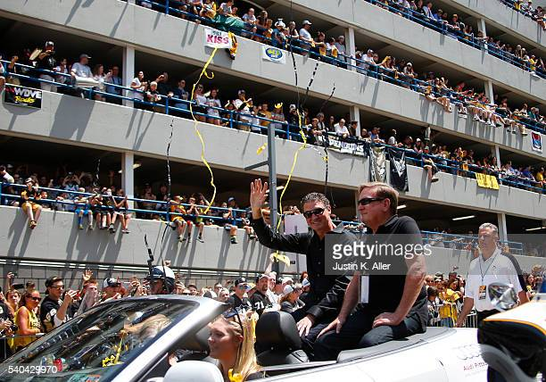 Mario Lemieux and Ron Burkle celebrate during the Victory Parade and Rally on June 15 2016 in Pittsburgh Pennsylvania
