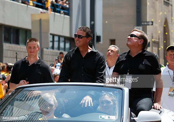 Mario Lemieux and Ron Burkle celebrate during the Victory Parade and Rally on June 15 2016 in Pittsburgh Pennsylvania The Penguins defeated the San...