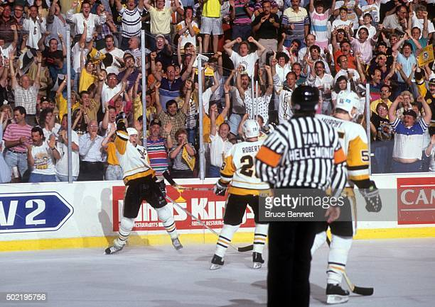 Mario Lemieux of the Pittsburgh Penguins celebrates a goal during Game 2 of the 1991 Stanley Cup Finals against the Minnesota North Stars on May 17...