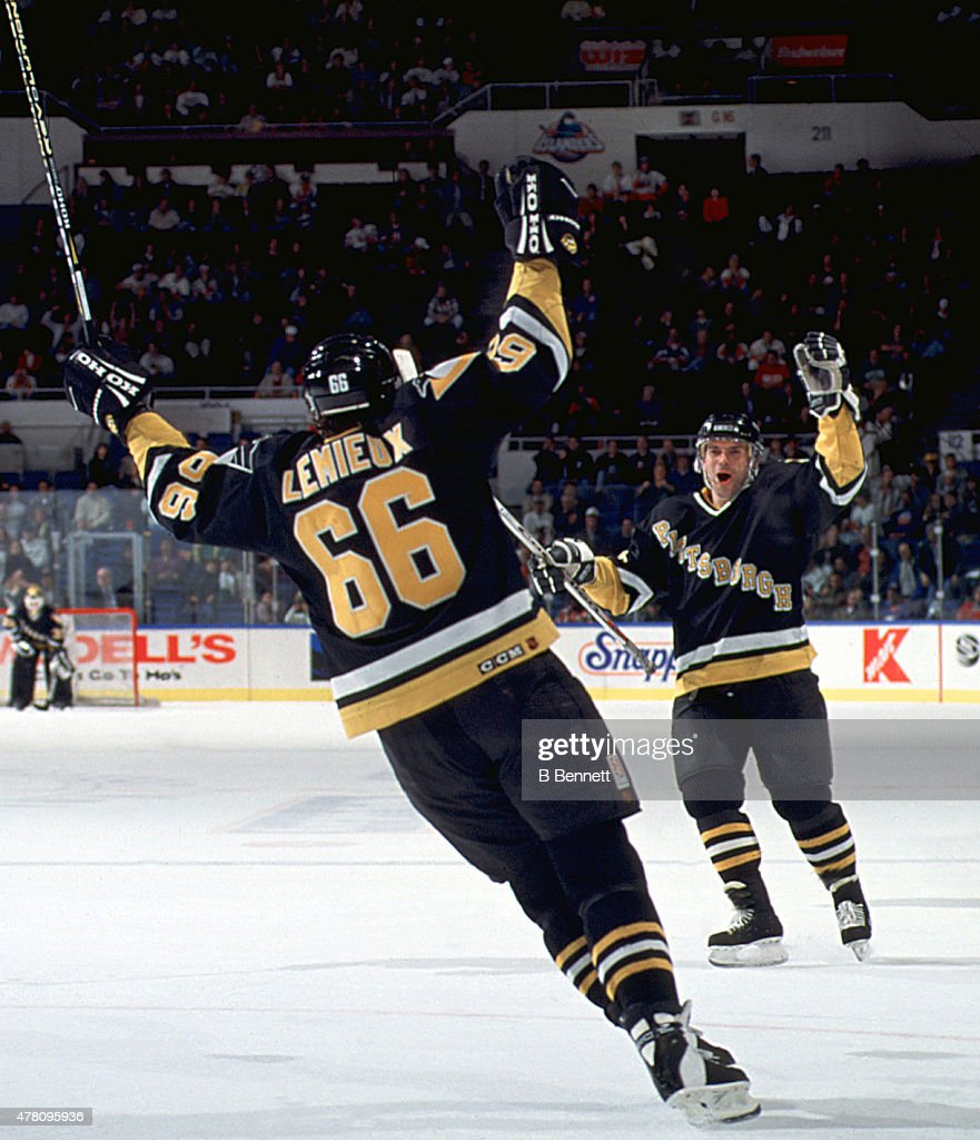 Mario Lemieux #66 of the Pittsburgh Penguins celebrates his hat trick with his 500th career goal during the game against the New York Islanders on October 25, 1995 at the Nassau Coliseum in Uniondale, New York.