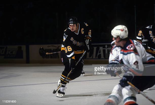 Mario Lemieux of the Pittsburgh Penguins skates on the ice during an NHL game against the New York Islanders on February 23 1997 at the Nassau...