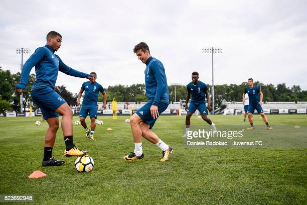Mario Lemina and Fabrizio Caligara of Juventus FC during the afternoon training session on July 27 2017 in Boston Massachusetts