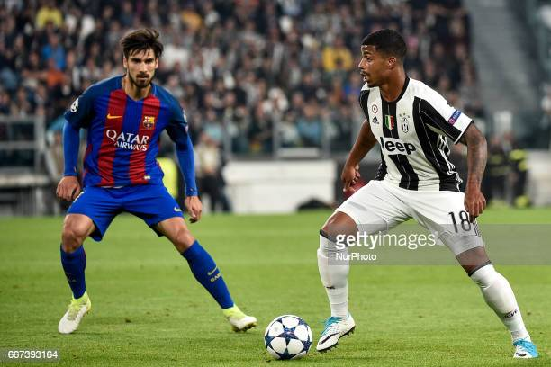 Mario Lemina of Juventus and Andr Gomes of FC Barcelona during the UEFA Champions League quarter final match between Juventus and Barcelona at the...