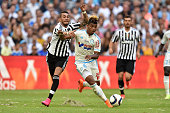 Mario Lemina of Olympique de Marseille is challenged by Roberto Maximiliano Pereyra of Juventus FC during the preseason friendly match between...