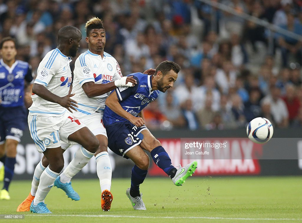 Mario Lemina of OM and <a gi-track='captionPersonalityLinkClicked' href=/galleries/search?phrase=Fabien+Camus&family=editorial&specificpeople=5702744 ng-click='$event.stopPropagation()'>Fabien Camus</a> of Troyes in action during the French Ligue 1 match between Olympique de Marseille (OM) and Troyes ESTAC at New Stade Velodrome on August 23, 2015 in Marseille, France.