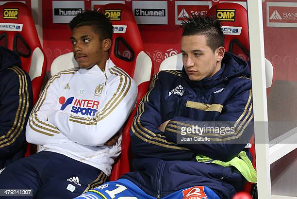 Mario Lemina of OM and Florian Thauvin of OM seat on the bench during the french Ligue 1 match between Stade de Reims and Olympique de Marseille at...