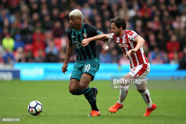 Mario Lemina of Southampton and Joe Allen of Stoke City compete for the ball during the Premier League match between Stoke City and Southampton at...