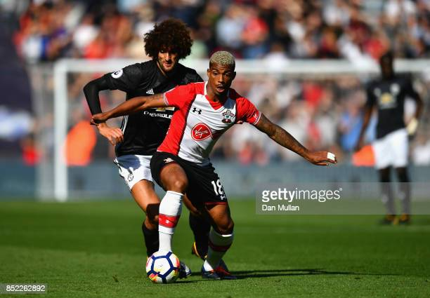 Mario Lemina of Southampton and Marouane Fellaini of Manchester United compete for the ball during the Premier League match between Southampton and...