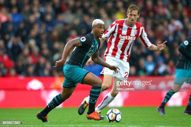 Mario Lemina of Southampton attempts to get past Peter Crouch of Stoke City during the Premier League match between Stoke City and Southampton at...