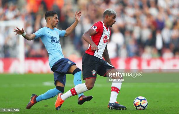 Mario Lemina of Southampton evades Ayoze Perez of Newcastle United during the Premier League match between Southampton and Newcastle United at St...