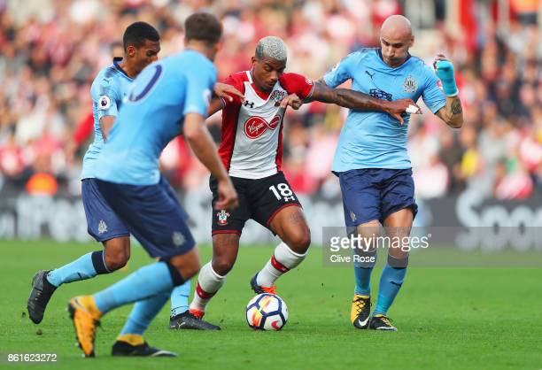 Mario Lemina of Southampton holds off Jonjo Shelvey of Newcastle United during the Premier League match between Southampton and Newcastle United at...