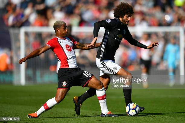 Mario Lemina of Southampton tackles Marouane Fellaini of Manchester United during the Premier League match between Southampton and Manchester United...