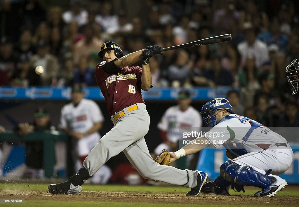 Mario Lisson (L) of Magallanes of Venezuela bats against Yaquis de Obregon of Mexico during the 2013 Caribbean baseball series on February 4, 2013 in Hermosillo, Sonora State, northern Mexico. AFP PHOTO/Ronaldo Schemidt