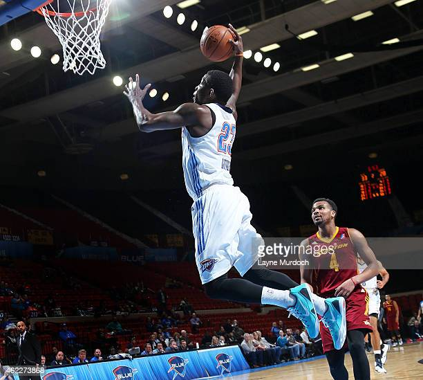 Mario Little of the Oklahoma City Blue dunks against Chris Crawford of the Canton Charge during an NBA DLeague game on January 23 2015 at the Cox...