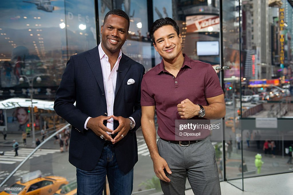 Mario Lopez and AJ Calloway host 'Extra' at their New York studios at HM in Times Square on September 30 2014 in New York City