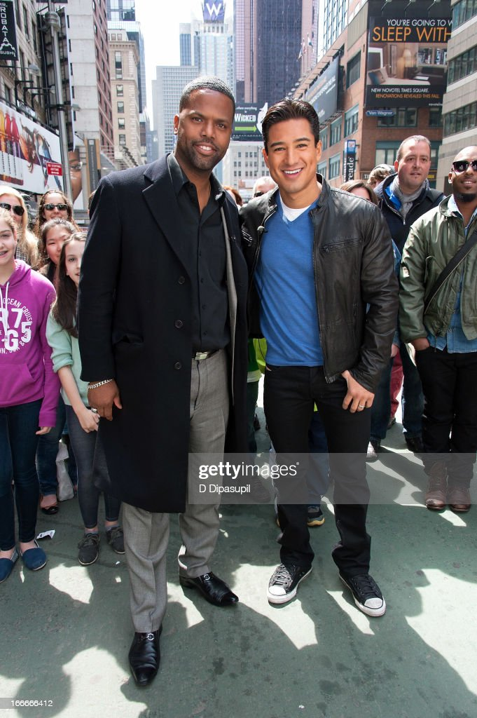 Mario Lopez (R) and AJ Calloway visit 'Extra' in Times Square on April 15, 2013 in New York City.